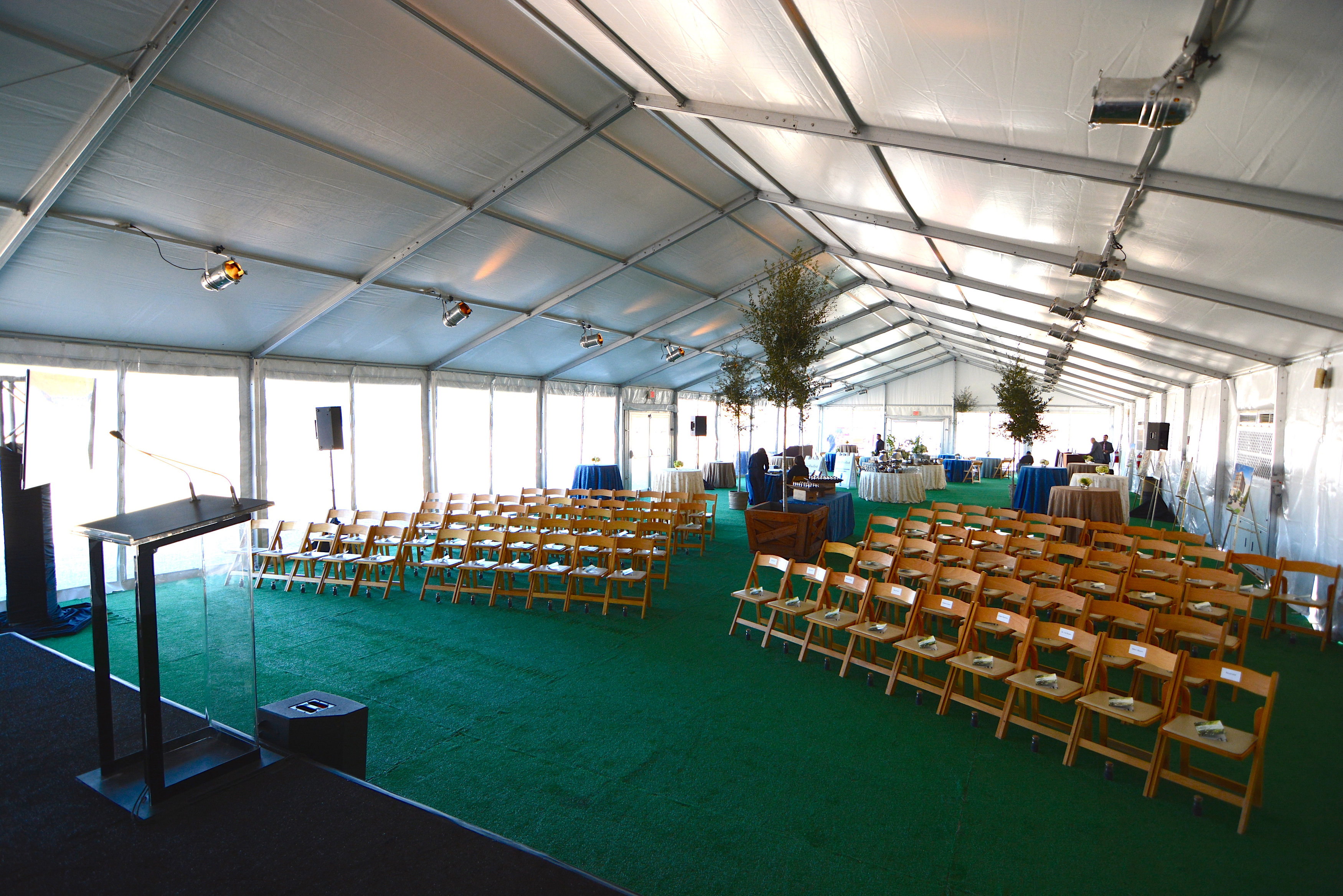 Inside White Structure Tent Rental With Seating Arrangement