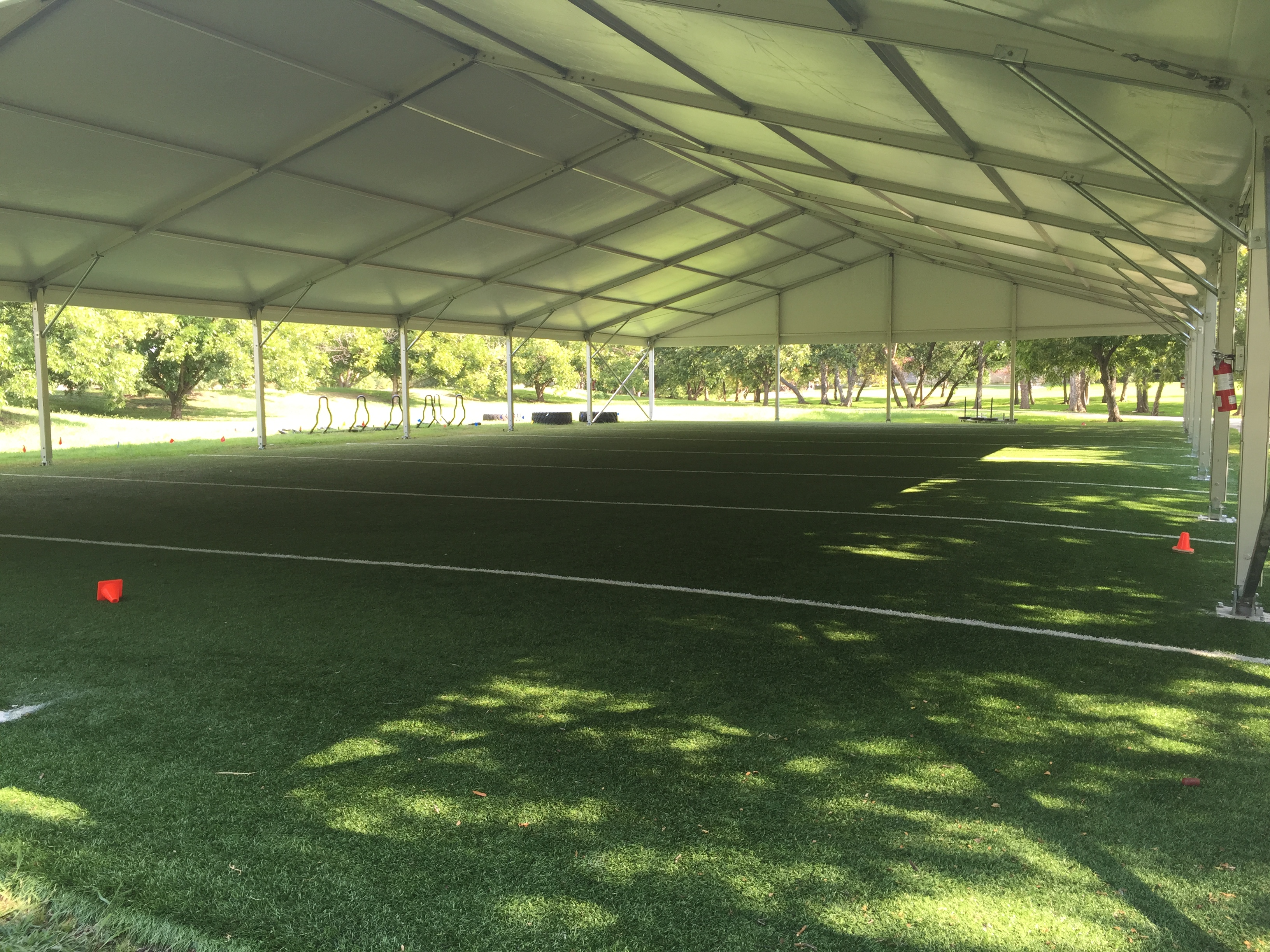 Practice Facility Covered by White Structure Tent Rental