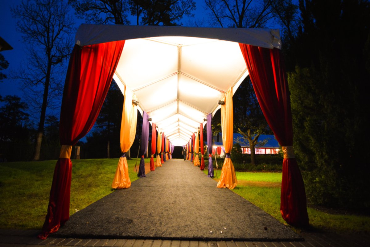 View Down Frame Tent Rental With Colorful Sashes