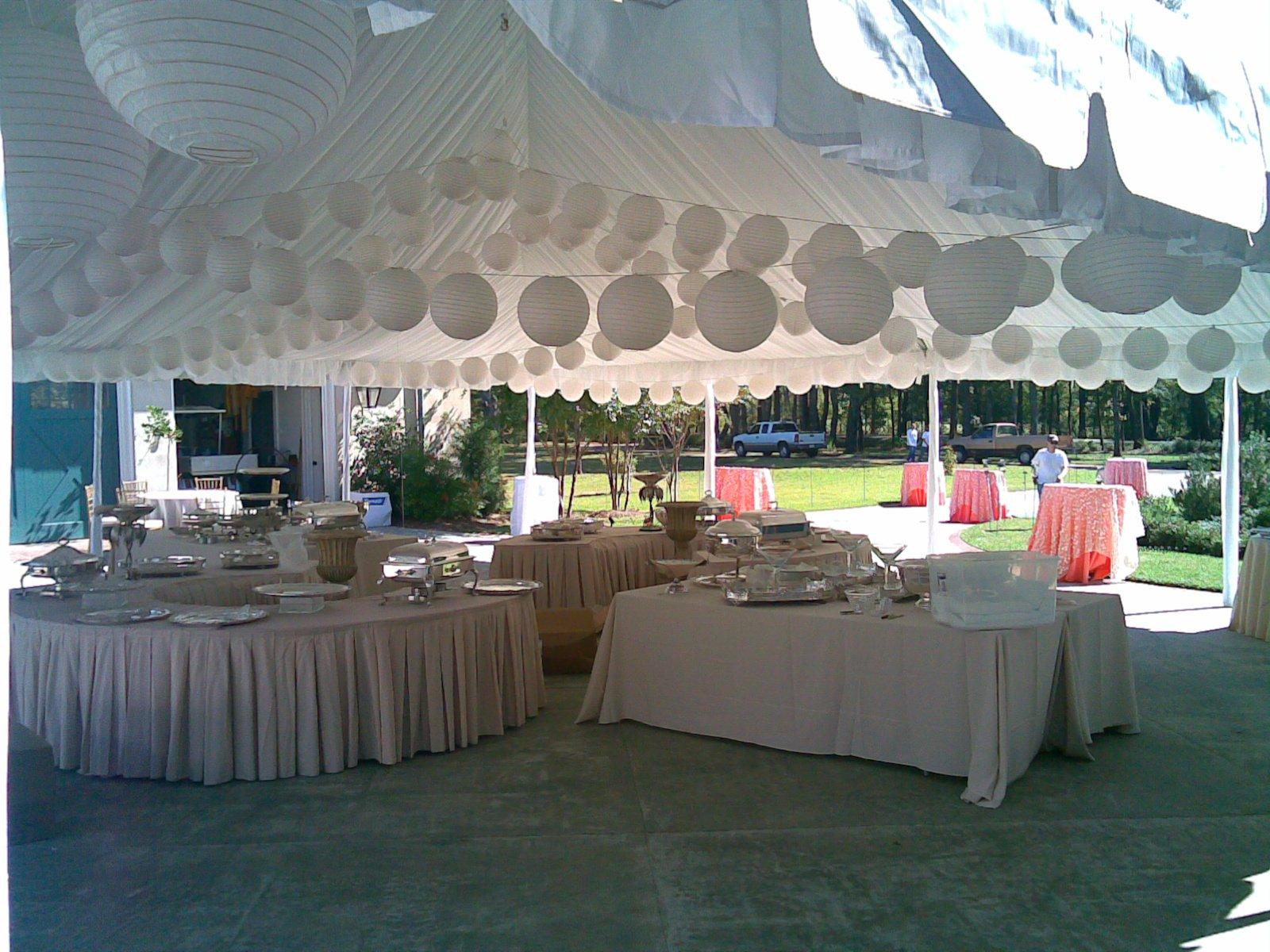 White Tables and Japanese Lanterns Under Frame Tent Rental