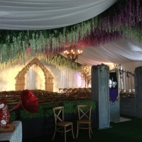 White Structure Tent Rental with Elegant Natural Looking Decor