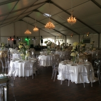 White Structure Tent Rental with Elegant Decor and Lighting
