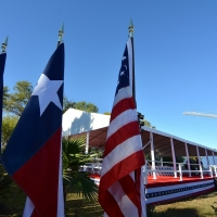 Port of Houston 100th Frame Tent Rental Behind Flags