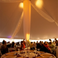 Elegant Decor and Lighting Under White Pole Tent Rental