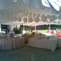 White Tables and Japanese Lanterns Under Frame Tent Rental
