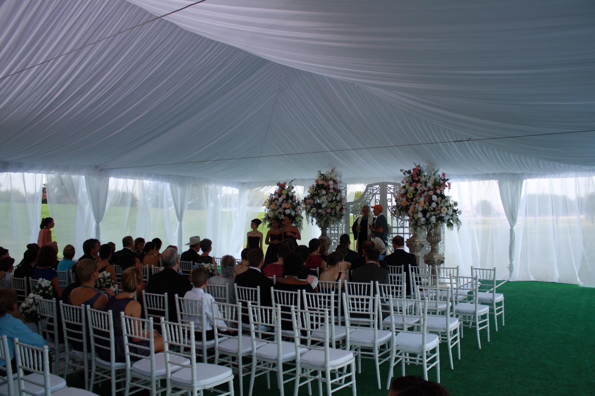 Elegant Wedding Ceremony Setup Inside Frame Tent