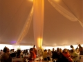 Elegant Decor and Lighting Under White Pole Tent Rental