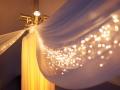 Elegant Decor and Lighting around Tent Pole