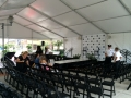 White Structure Tent Rental With Seating and Staging