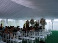 Elegant Wedding Ceremony Setup Inside Frame Tent