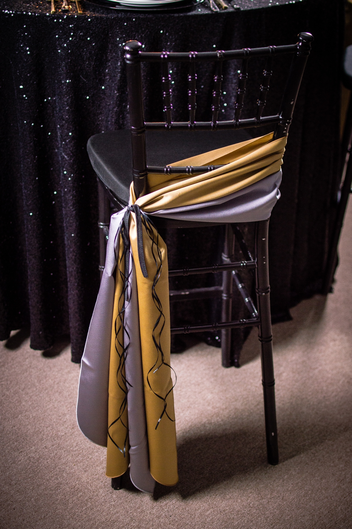 Gold and Silver Sashes on a Black Chiavari Chair