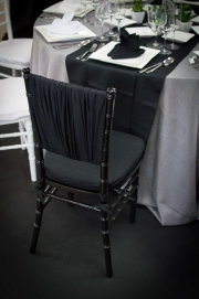 Two Black Chiavari Chairs Contrasting White Chairs