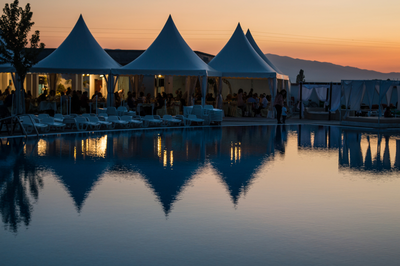 Outdoor Pole Tent near Pool in Beautiful Sunset Reflection at Dusk