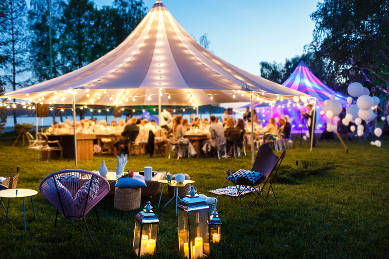 Colorful Wedding Pole Tent with Outdoor Lighting at Dusk