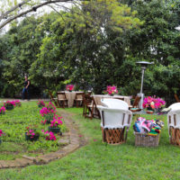 Floral Reception Area in Backyard Grass at Sweet August Backyard Wedding